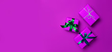 Christmas Gift Boxes On Purple Background.