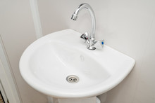 The Photo Of A Sink In A Bathr...