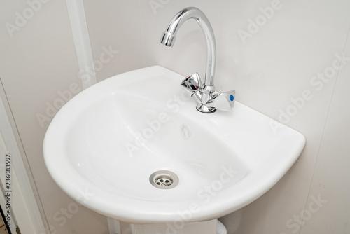 Fotografía  The photo of a sink in a bathroom