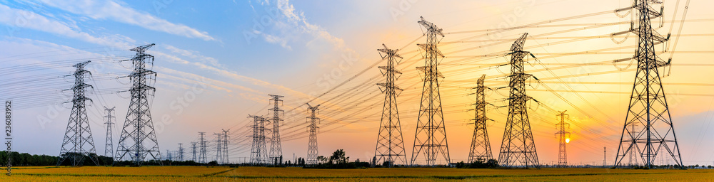 Fototapeta high-voltage power lines at sunset,high voltage electric transmission tower