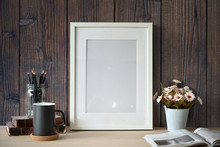 Mockup White Poster With Home Office Supplies Over Wooden Wall.