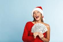 Cheerful Young Woman Wearing Santa Claus Hat