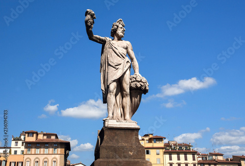 Poster Historisch mon. Dionysus sculpture standing on street of Florence. The god of the grape-harvest, winemaking and wine under the streets of historical Firenze, Italy