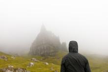 Woman Wearing Hood By Old Man Of Storr On Isle Of Skye, Scotland