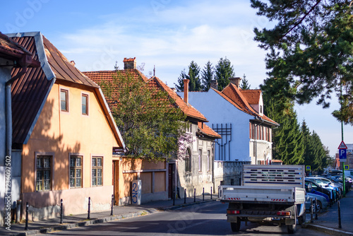 Photo  Brasov old architecture buildings and parked cars