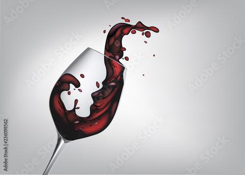 Fotografie, Obraz  agiter un verre de vin rouge pour faire des éclaboussures sur un fond gris