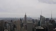 New York cityscape time-lapse from the Rockefeller building. The Chrysler and Empire State Buildings are visible. Shot in New York City, USA.