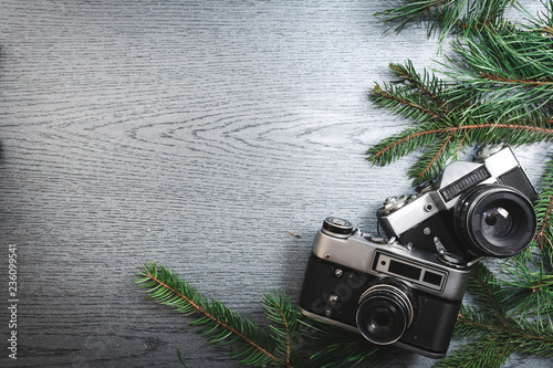 Obraz Top View of Vintage Camera Between Christmas tree, on Wooden Texture, copy space - fototapety do salonu