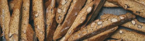 Slika na platnu Italian biscuits Biscotti laid out randomly on a baking sheet.