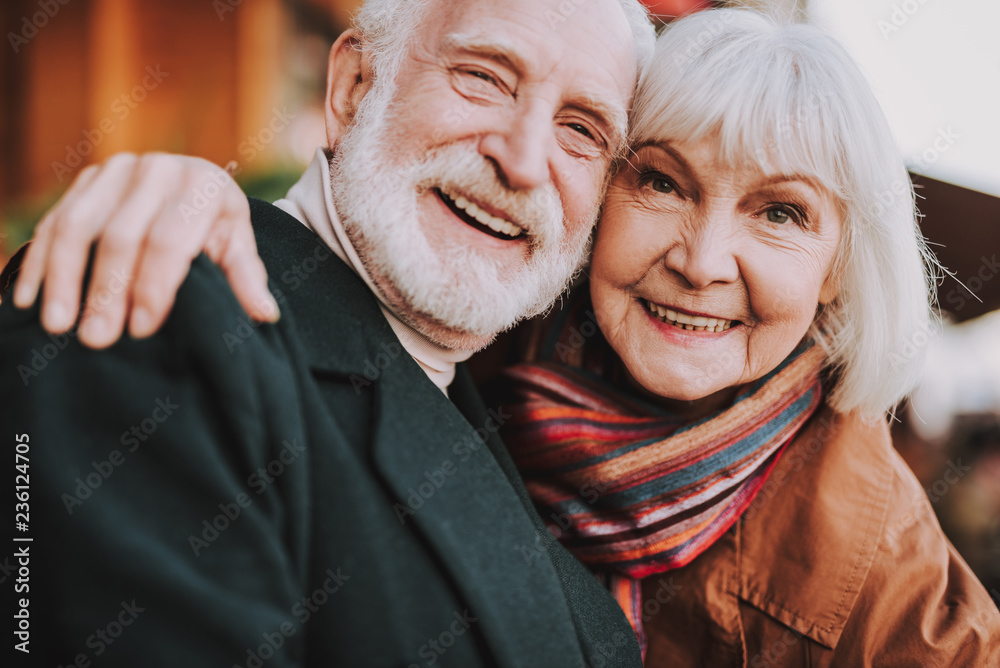 Fototapety, obrazy: Close up portrait of happy senior lady hugging her joyful husband. They looking at camera and smiling