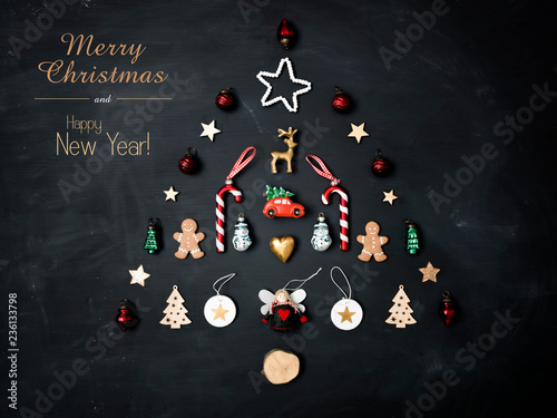 Fotografía  merry christmas lettering and christmas tree shaped out of different Christmas d