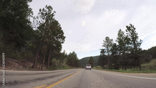 Fototapete - Driving on paved road in Rocky Mountain National Park.