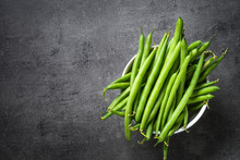 Green Beans On Black Background.