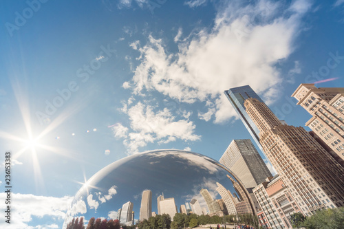 Poster de jardin Chicago Low angle view of Chicago downtown skylines and reflection, cloud blue sky