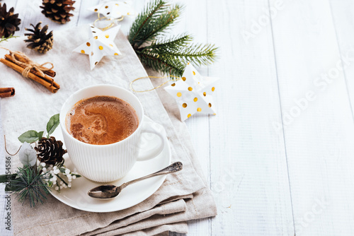 Cup Of Hot Chocolate With Cinnamon Sticks On The White