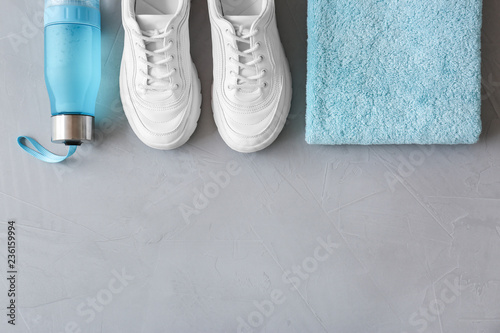 Flat lay composition with fitness equipment and space for text on gray background