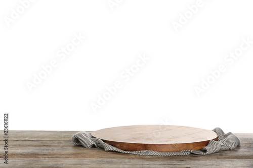 Wooden board and napkin on table against white background