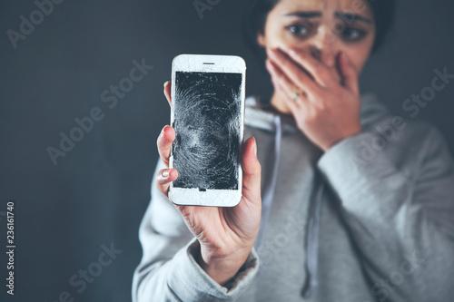 sad woman hand broken phone
