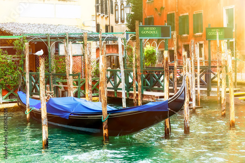 Spoed Foto op Canvas Gondolas Canal with gondola in Venice with gondola service sign. Tourism concept in Europe