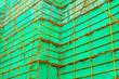Leinwanddruck Bild - Steel scaffolding with a green curtain
