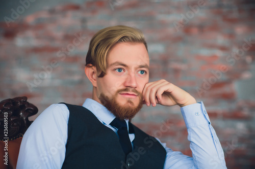 Portrait of blonde young man with uncommon appearance wears white t shirt Wallpaper Mural