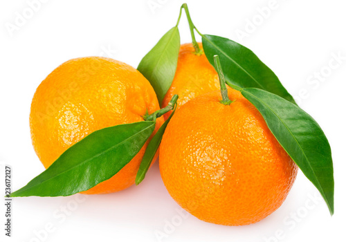 Fresh mandarine with leaf on white background