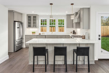 Kitchen In New Home With Bar S...