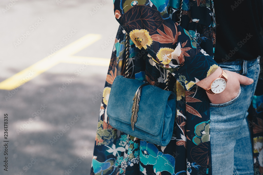 Fototapety, obrazy: Close-up of a woman wearing a watch and holding a purse