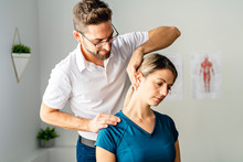 A Modern Rehabilitation Physiotherapy Man At Work With Woman Client