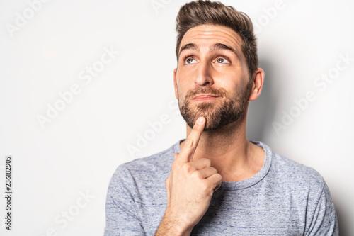 Obraz na plátně A nice guy in studio white, pointing something