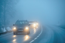 Cars On The Road In The Fog
