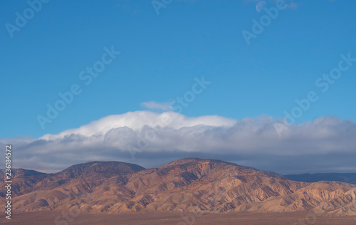 storm clouds over desert mountains