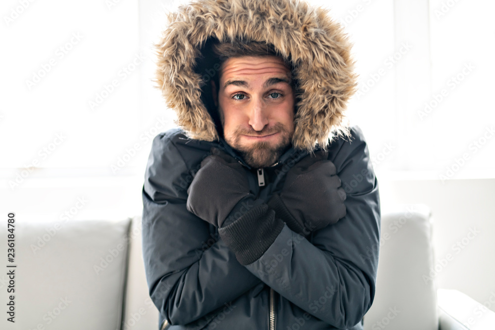 Fototapety, obrazy: A Man have cold on the sofa at home with winter coat