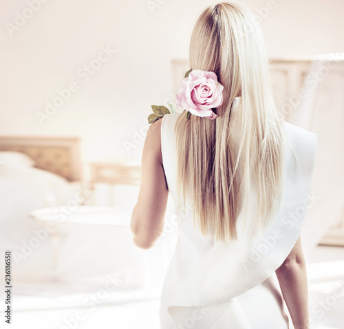 Foto op Canvas Artist KB Backside portrait of a blond lady in a luxurious apartment