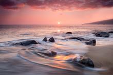 Foamy Waves On Beach At Sunset