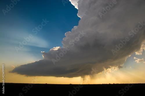 Fényképezés  cloudy sunset over field