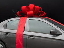 Gray Car With Red Ribbon On Black