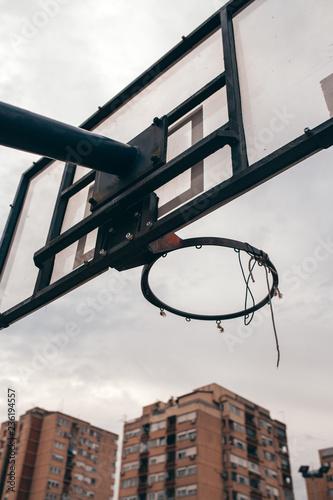 Obraz na plátně Street ball basketball board with torn net