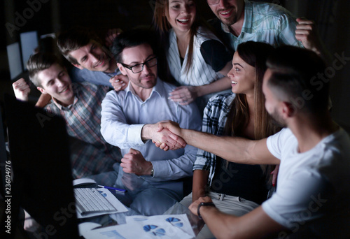 handshake of business people in the circle of colleagues