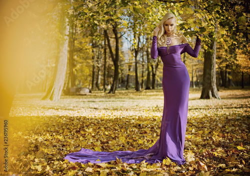 Foto op Canvas Artist KB Elegant, sensual woman walking in the autumnal forest