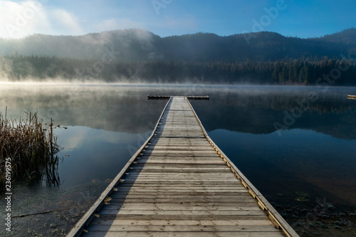 Photo Stands Lake Mist rising off water