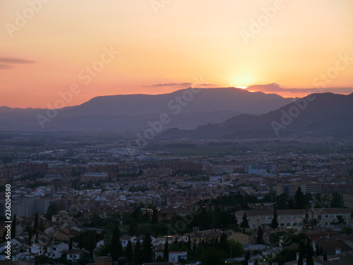 Poster Athens Panorama of a beautiful orange sunset over the city of Granada, Spain