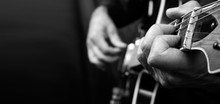 Guitarist Hands And Guitar Close Up. Playing Electric Guitar. Copy Spaces. Black And White.