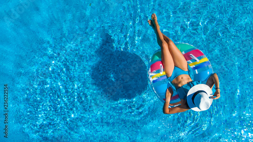 Aerial top view of beautiful girl in swimming pool from above, relax swim on inf Canvas Print