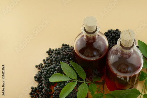 b6e18660a8ce Elderberry syrup.Tincture of elderberry berries in a glass bottle ...