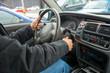 Man driving car. Hands on steering wheel