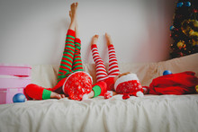 Little Boy And Girl Relax At Christmas Home
