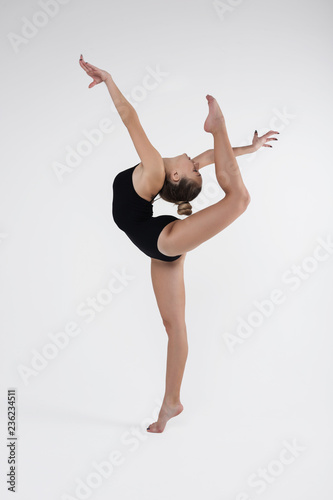 Keuken foto achterwand Gymnastiek Beautiful young woman limber exerciser in the studio