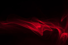 Red Smoke (evaporation) On A Black Background