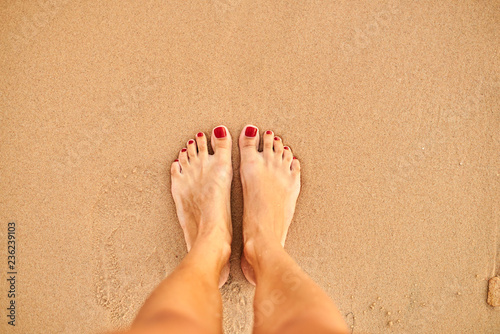 Poster Pedicure feet on the beach